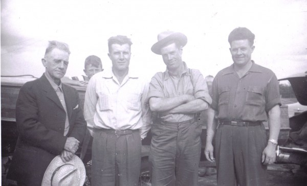W. Cloyd Foster with sons Max, Don and Lawrence. Grandson Dale is peeking